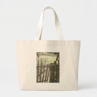 Old wooden gate covered in ivy and moss canvas bag