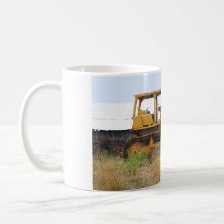 Old Yellow Bulldozer Parked In A Pasture Basic White Mug