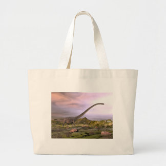 Omeisaurus walking in the desert by sunset large tote bag