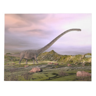 Omeisaurus walking in the desert by sunset notepad