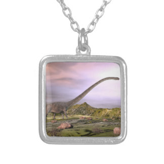 Omeisaurus walking in the desert by sunset silver plated necklace