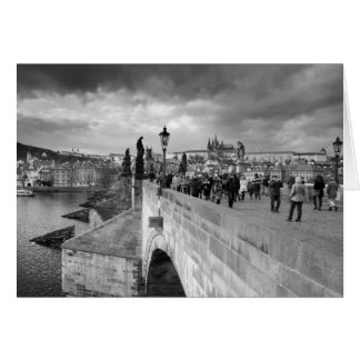 on the Charles Bridge under a stormy sky in Prague Card