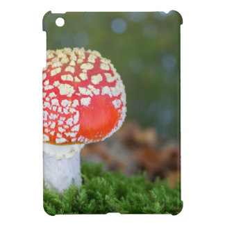 One fly agaric with green moss in fall season cover for the iPad mini
