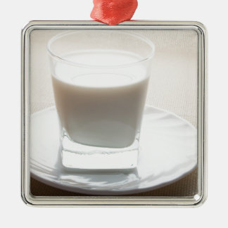One glass of milk on a white saucer in backlit Silver-Colored square decoration