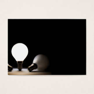 One light bulb shining in a dark space