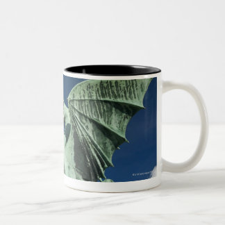 One of the four bronze dragons on the Dragon Two-Tone Coffee Mug