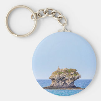 One outstanding rock rising from sea level basic round button key ring