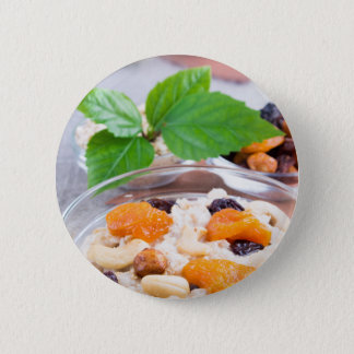 One portion of oatmeal with fruit and berries 6 cm round badge