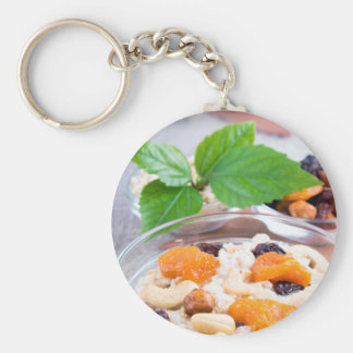 One portion of oatmeal with fruit and berries key ring
