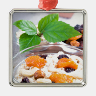 One portion of oatmeal with fruit and berries metal ornament