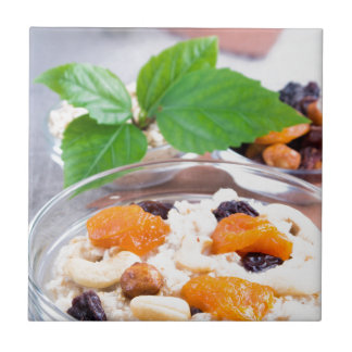 One portion of oatmeal with fruit and berries tile