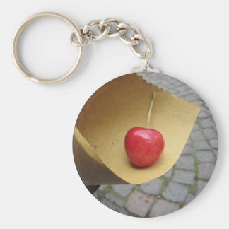 One red cherry on straw food paper key ring