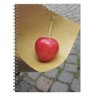 One red cherry on straw food paper notebook
