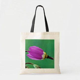 One shooting star flower against green  flowers canvas bag