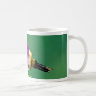 One shooting star flower against green coffee mugs