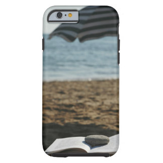 Open book with a roller tough iPhone 6 case