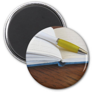 Opened blank lined notebook with pen 6 cm round magnet