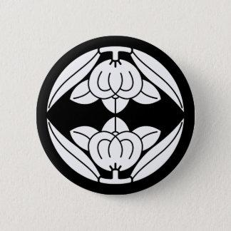 Opposite it is, the orange 6 cm round badge