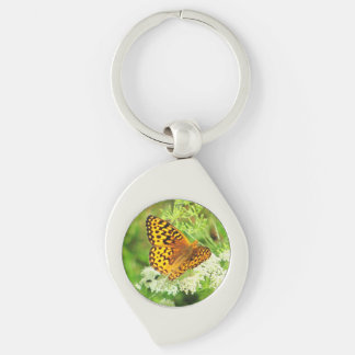 Orange and Black Butterfly on White Flower Keychains