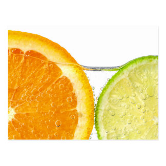 Orange and lime slices in water postcard