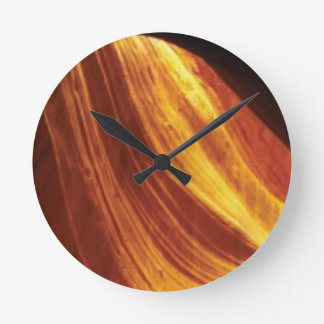 orange and red flow round clock
