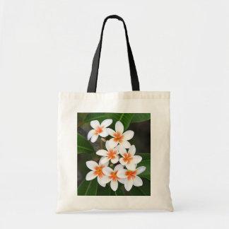 orange and white frangipani bags