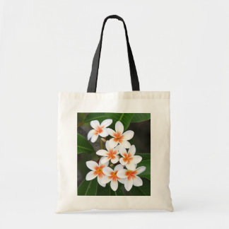 orange and white frangipani tote bag