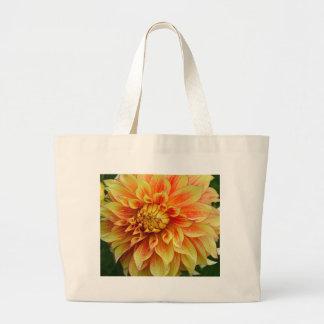 Orange and yellow dahlia flower canvas bag
