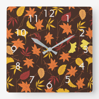 Orange and Yellow Fall Leaves on Brown Wall Clock