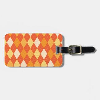 Orange argyle pattern bag tag