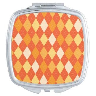 Orange argyle pattern makeup mirrors