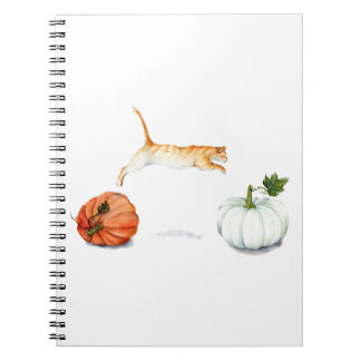 Orange Cat Jumping Between Pumpkins Notebook