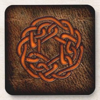 Orange celtic knot on leather coasters