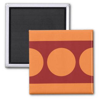 Orange Circles on Red Square Magnet