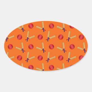 orange cricket pattern oval sticker