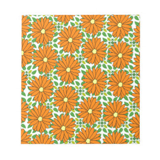 orange daisies on green leaves notepads