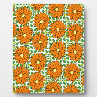 orange daisies on green leaves plaque