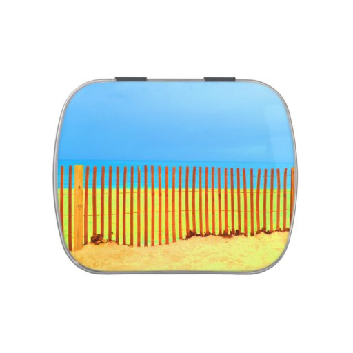 orange fence yellow beach blue sky florida jelly belly tin