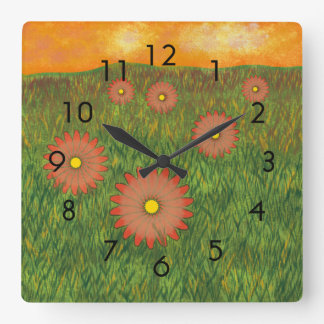 Orange Flowers in Green Pasture at Sunset Painting Square Wall Clock