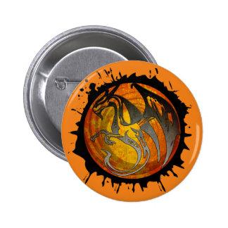 Orange grunge paint splatter dragon round button