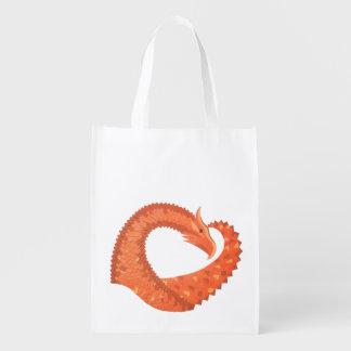 Orange heart dragon on white reusable grocery bag