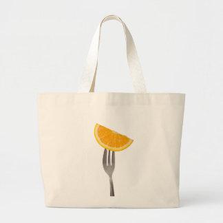Orange held by a fork bags