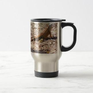 Orange Iguana hunts Travel Mug