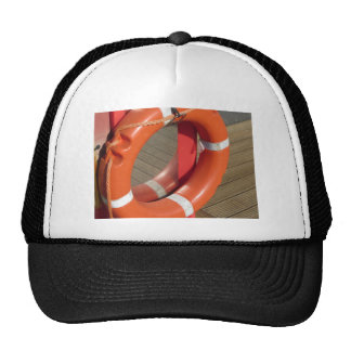 Orange lifebuoy on wooden pier in the harbor cap