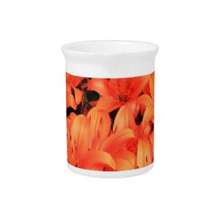 Orange liliums in bloom pitcher