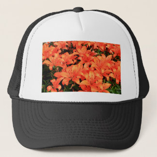 Orange liliums in bloom trucker hat