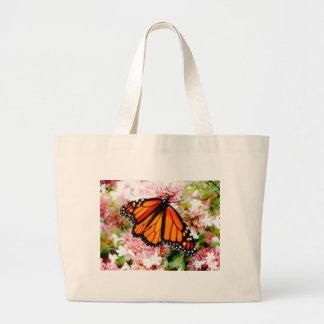 Orange Monarch on pink flowers Large Tote Bag