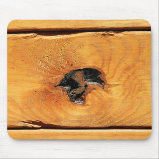 Orange natural wood with black hole and spiderweb mouse pad
