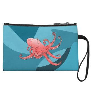 Orange octopus in the blue ocean. wristlet clutches