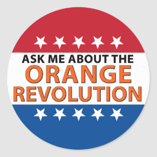 ORANGE REV BUTTON ROUND STICKER